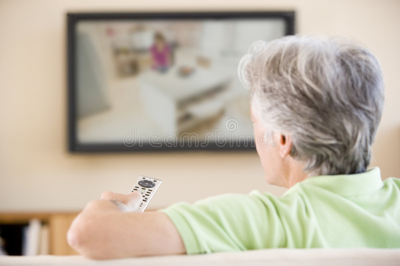 Download Man Watching Television Using Remote Control Stock Images - Image: 5941994