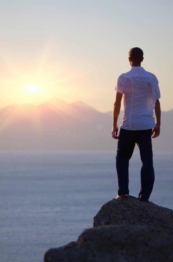Free Man Watching The Sunset Stock Image - 29980721