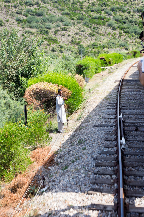 Man watching train Travel coming from Peshawar and he happy in S. Swabi, PAKISTAN - Sept 27:Man watching train Travel coming from Peshawar and he happy in Swabi stock images