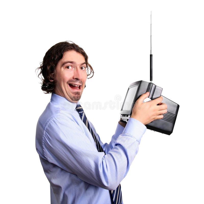 Download Man watching TV stock photo. Image of holding, watching - 13369914