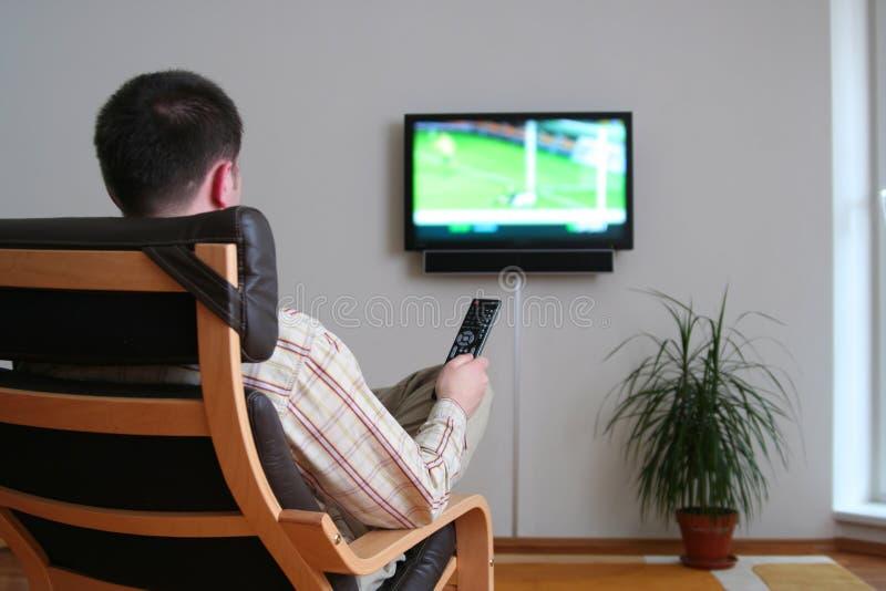 Download Man watching TV stock photo. Image of watching, sitting - 4946962