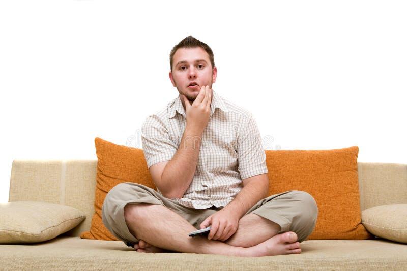 Man watching tv royalty free stock photos