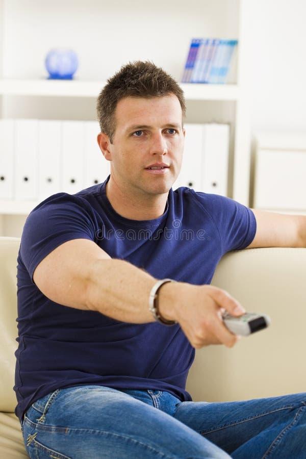 Download Man watching TV stock photo. Image of interior, comfort - 7657022