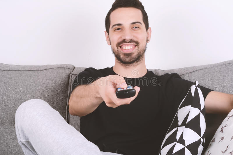Man watching tv on couch. royalty free stock photo