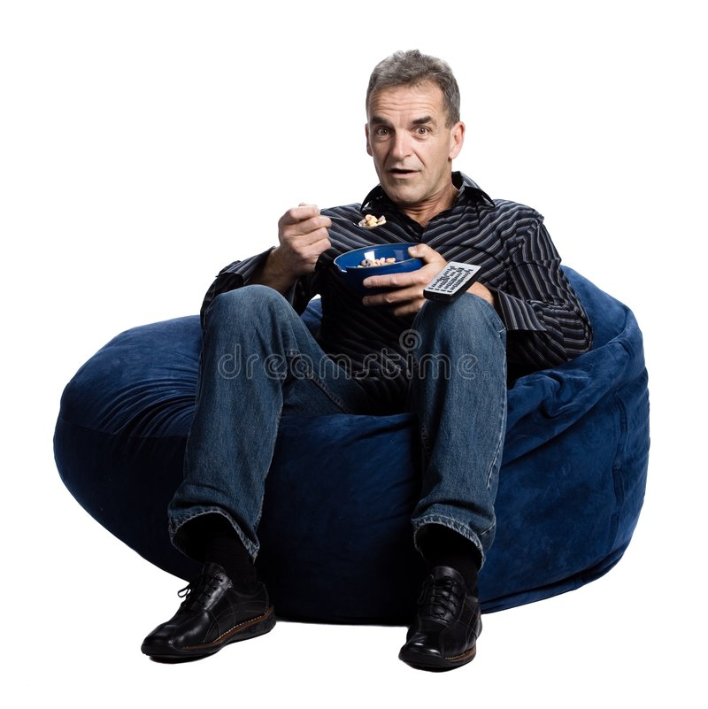 Download Man watching tv and eating stock image. Image of fashion - 2404033