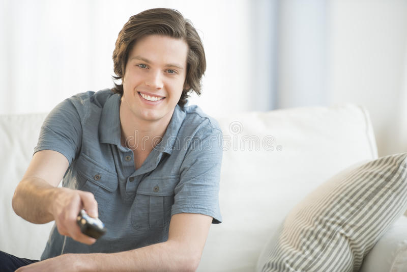 Download Man Watching TV At Home stock photo. Image of focus, room - 40422082
