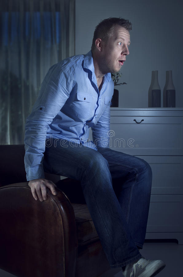 Download Man watching TV jumps up stock photo. Image of display - 21811816