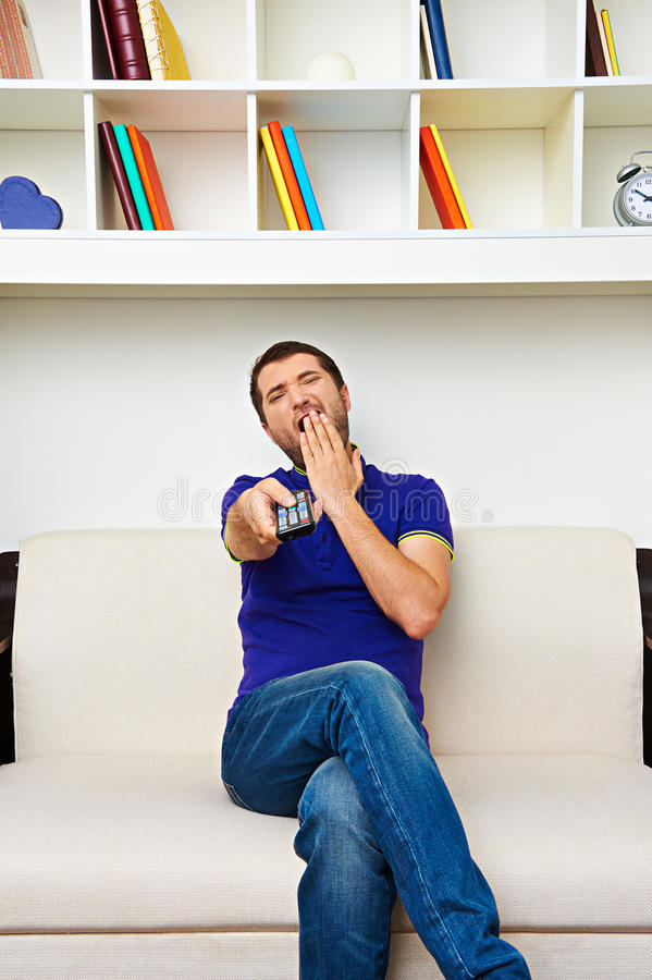 Download Man Watching Tv And Yawning Stock Image - Image: 31251605