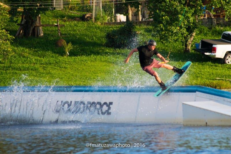 Man on water board stock photo