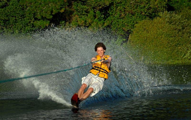 Man water skiing on lake royalty free stock images