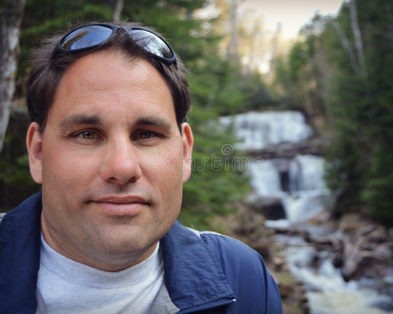 Man by Waterfall stock photo