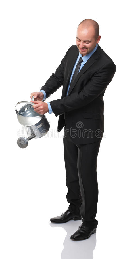 Man watering. Caucasian man watering action on white background royalty free stock photos