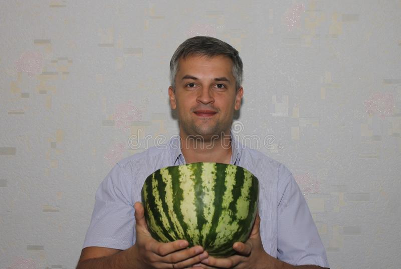 A man with a watermelon in his hands stock photo