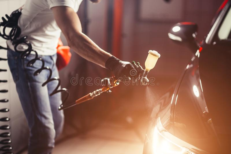 Car wash and coating business with ceramic coating.Spraying varnish to car. stock photography