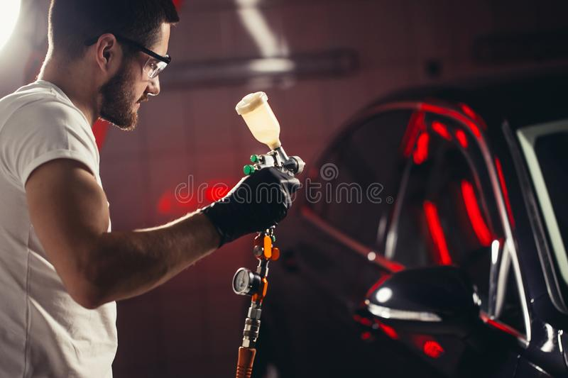 Car wash and coating business with ceramic coating.Spraying varnish to car. stock photos