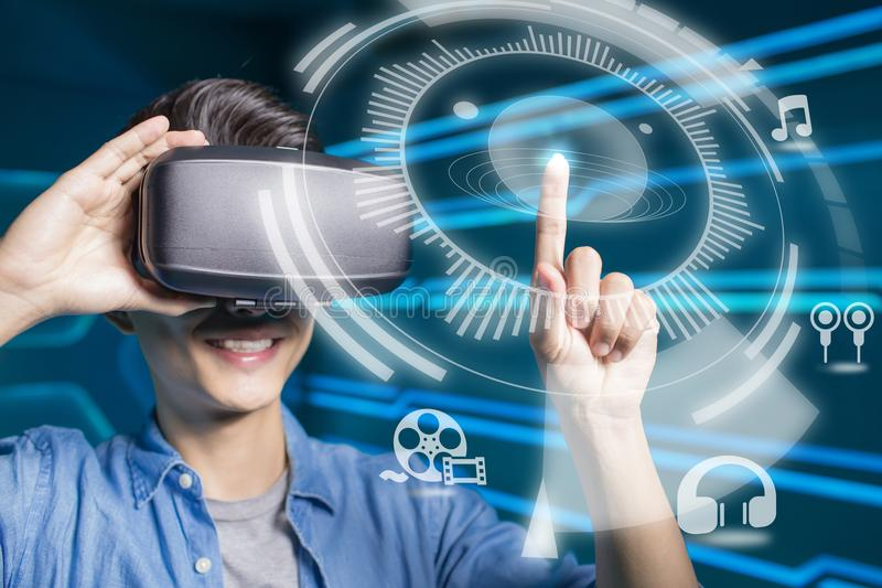 Man wear vr play audio and video. With on a technology background royalty free stock image