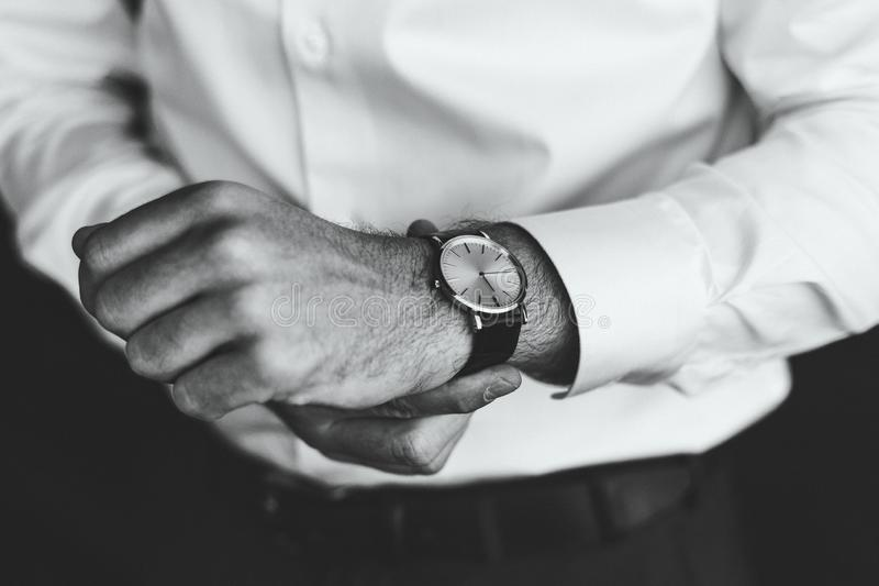 Man wear watches. Black and white. Business style royalty free stock image