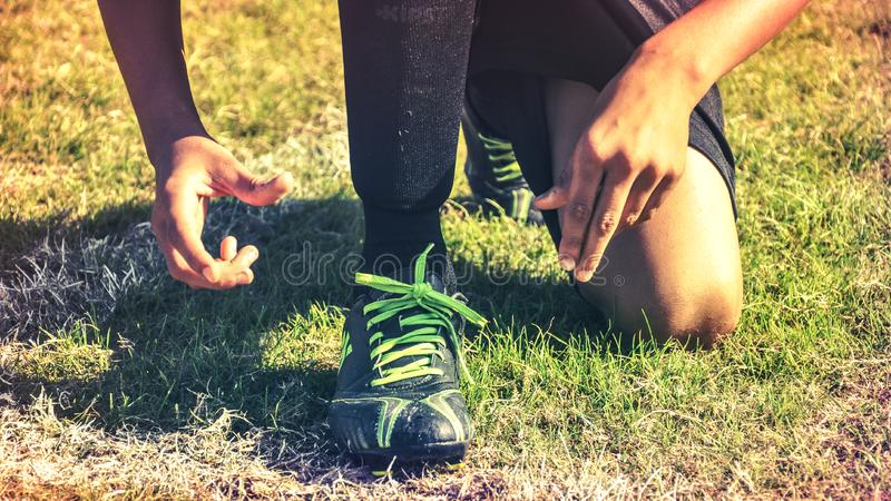 Man wearing athletic shoes in grassy field royalty free stock photo