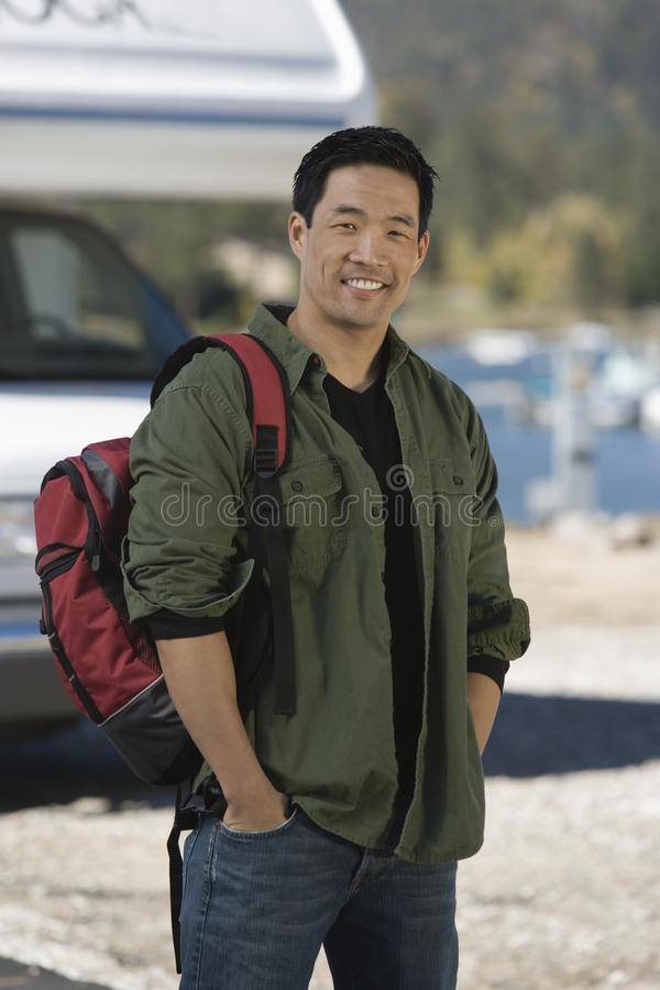 Man wearing backpack by RV royalty free stock photo