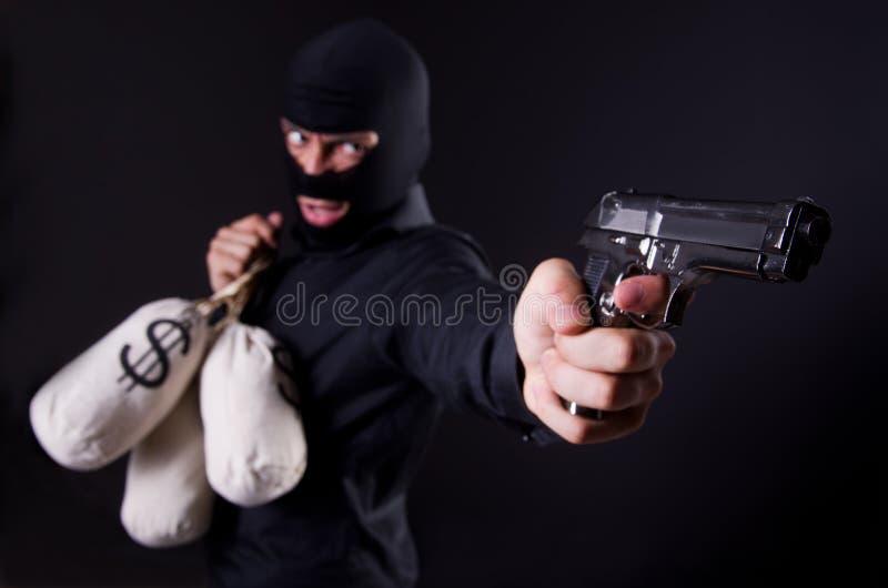 Man wearing balaclava stock images