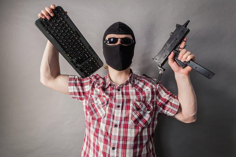 Man wearing balaclava shooting from gun stock images