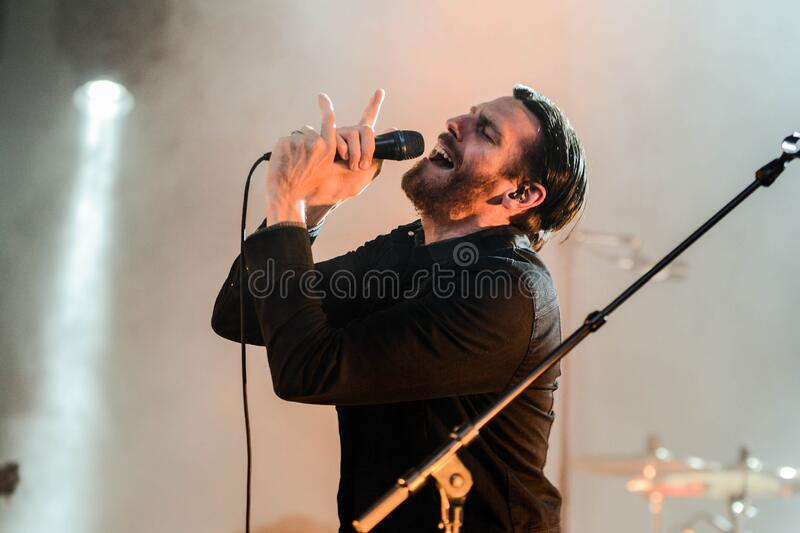 Man Wearing Black Collared Long Sleeve Shirt Holding Microphone royalty free stock photography