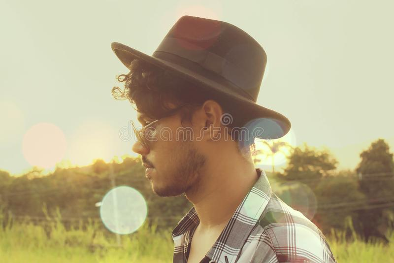 Man Wearing Black Hat and Sunglasses stock image