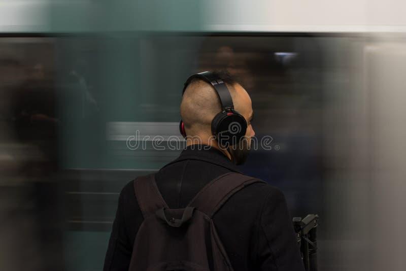 Man Wearing Black Headphones stock image