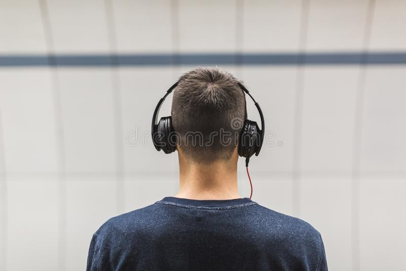 Man Wearing Black Headphones stock photo