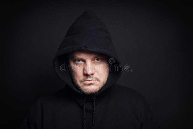 Man wearing black hoodie royalty free stock image