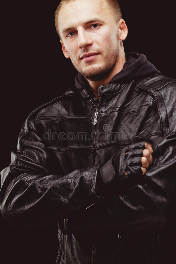 Man wearing black leather jacket royalty free stock photos