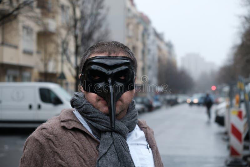 Man wearing a black mask. Man wearing a doctor plague black mask royalty free stock images