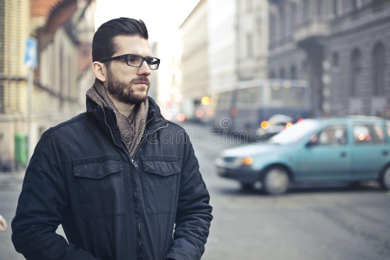 Man Wearing Black Zip-up Jacket Standing on the Street stock photos