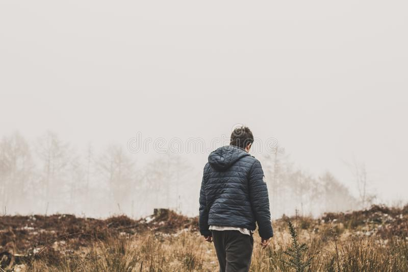 Man Wearing Blue Bubble Jacket royalty free stock photo