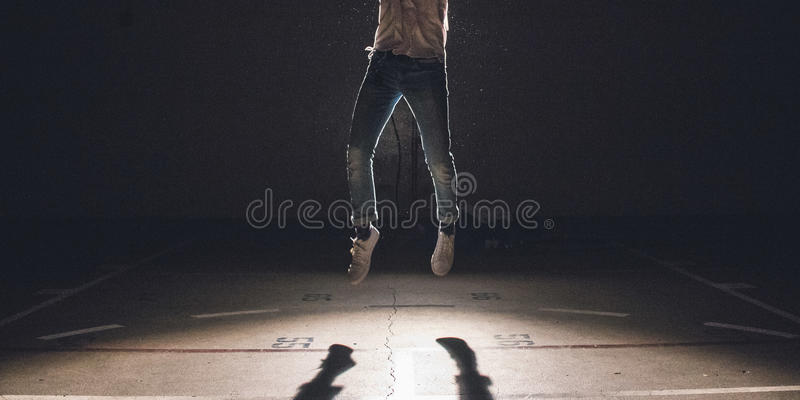 Man Wearing Blue Denim Pants And White Sneakers Jumping Over Concrete Ground Free Public Domain Cc0 Image