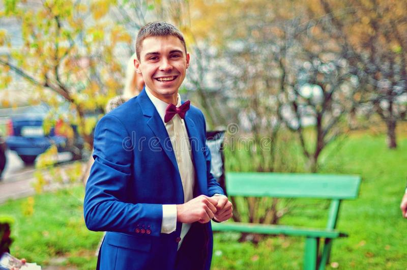 Man Wearing Blue Suit in Park stock photos