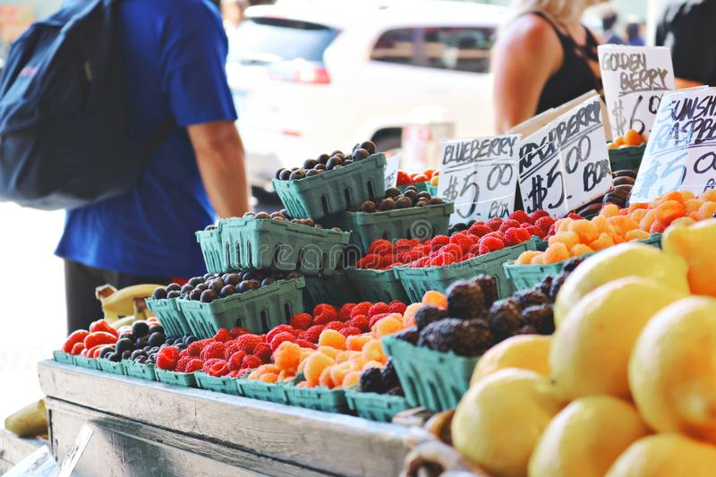 Man Wearing Blue Top and Black Bottom Standing Near Fruit Stand royalty free stock image