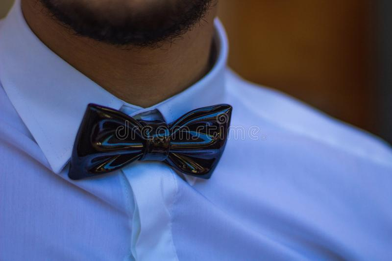 Man wearing a Bow Tie. A man wearing a bow tie on a white shirt stock image