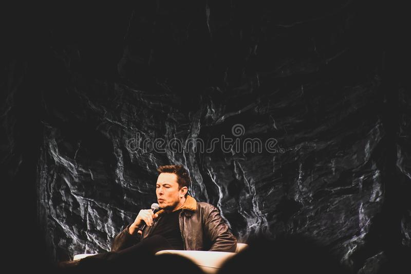 Man Wearing Brown Bomber Jacket Holding Microphone stock images