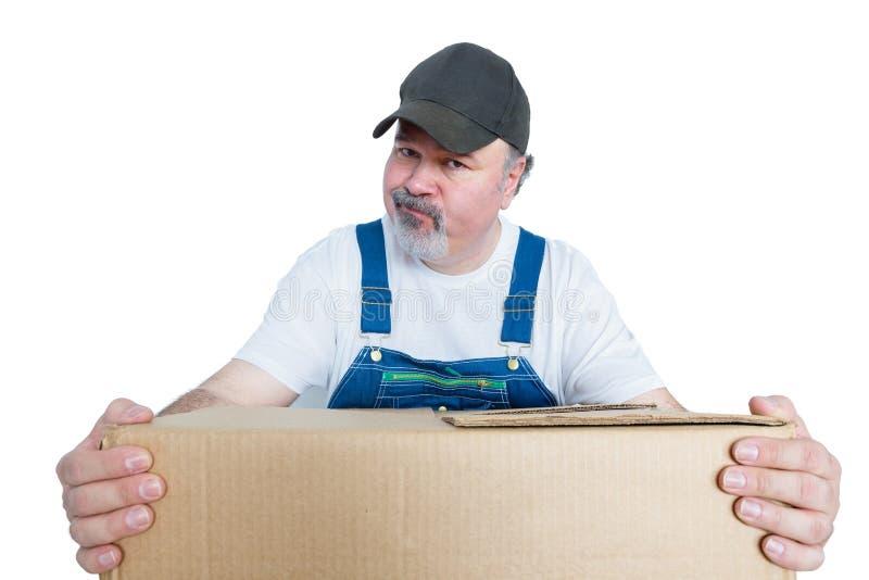 Man wearing cap holding large cardboard box royalty free stock images