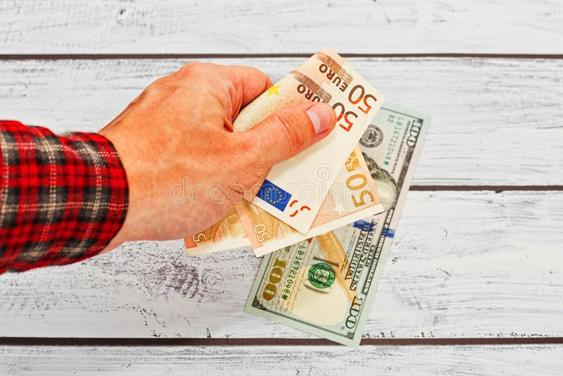 Male person exhange euro to US dollars stock image