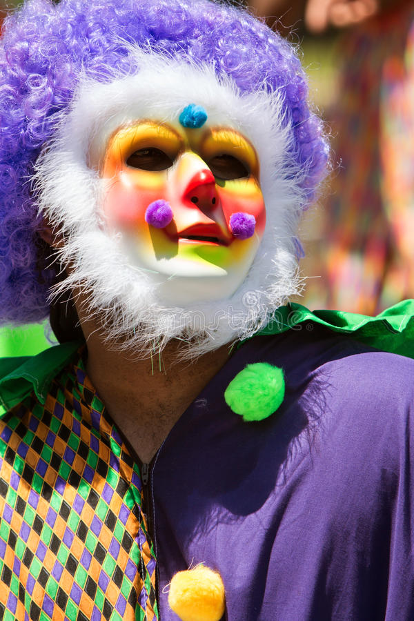 Man Wearing Colorful Clown Costume And Mask Celebrates Caribbean Culture stock images