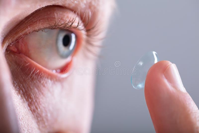 Man Wearing Contact Lens royalty free stock images