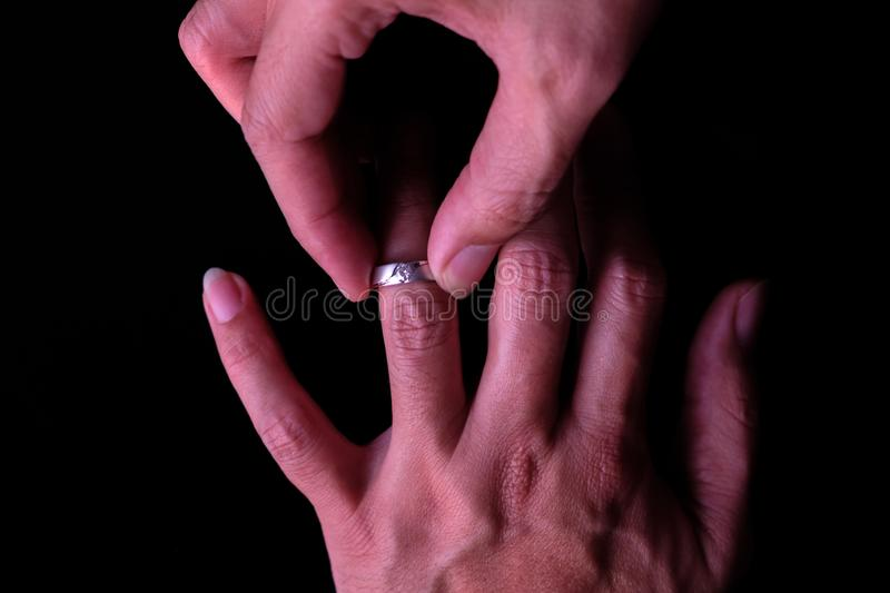 Man wearing a diamond ring. stock image