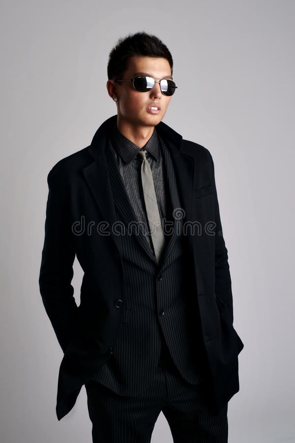 Download Man Wearing Elegant Black Suit And Sunglasses Stock Image - Image of trendy, sunglasses: 16549521