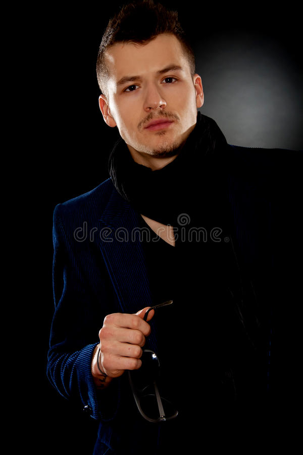 Man wearing elegant blue suit stock image