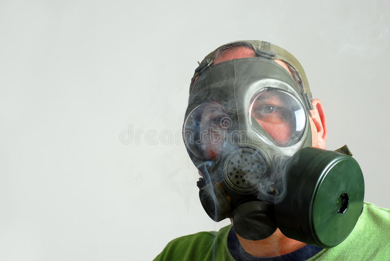 Man wearing a gas mask to avoid second hand smoke