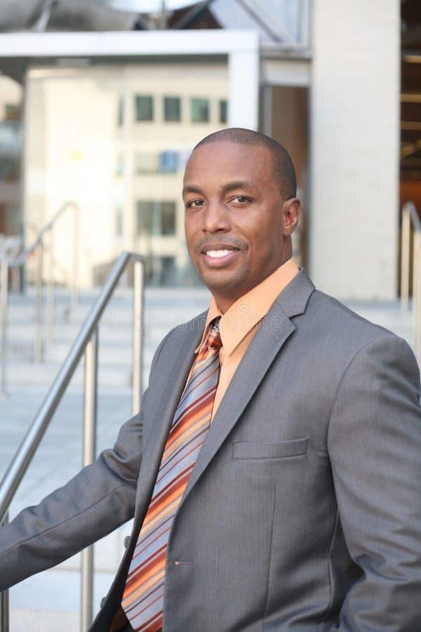 Man Wearing Gray Blazer and Orange Dress Shirt stock images