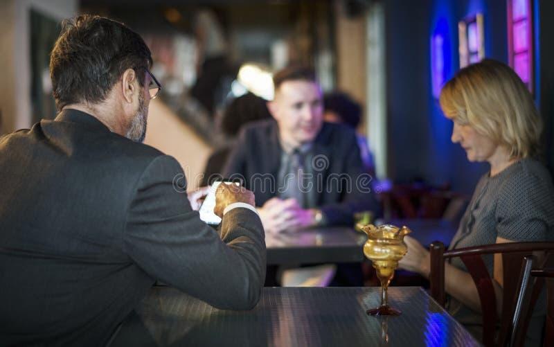 Man Wearing Gray Blazer Sitting on Chair Near Woman Wearing Gray T-shirt royalty free stock image
