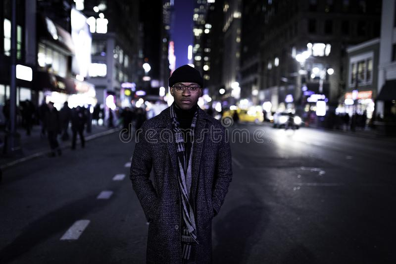 Man Wearing Gray Coat Standing in the Middle of the Road stock photography